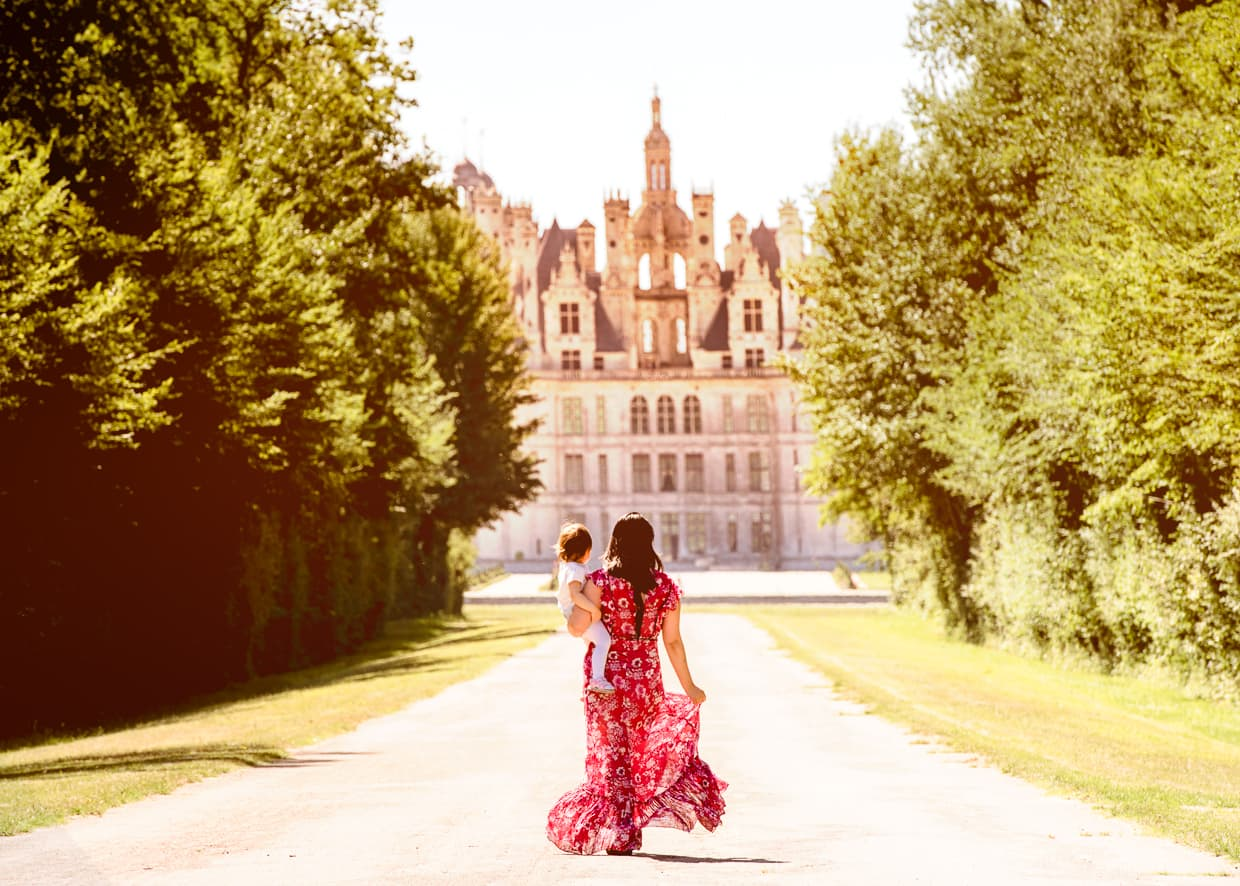 The French Chateau de Chambord at the end of a tree lined road in the Loire Valley.