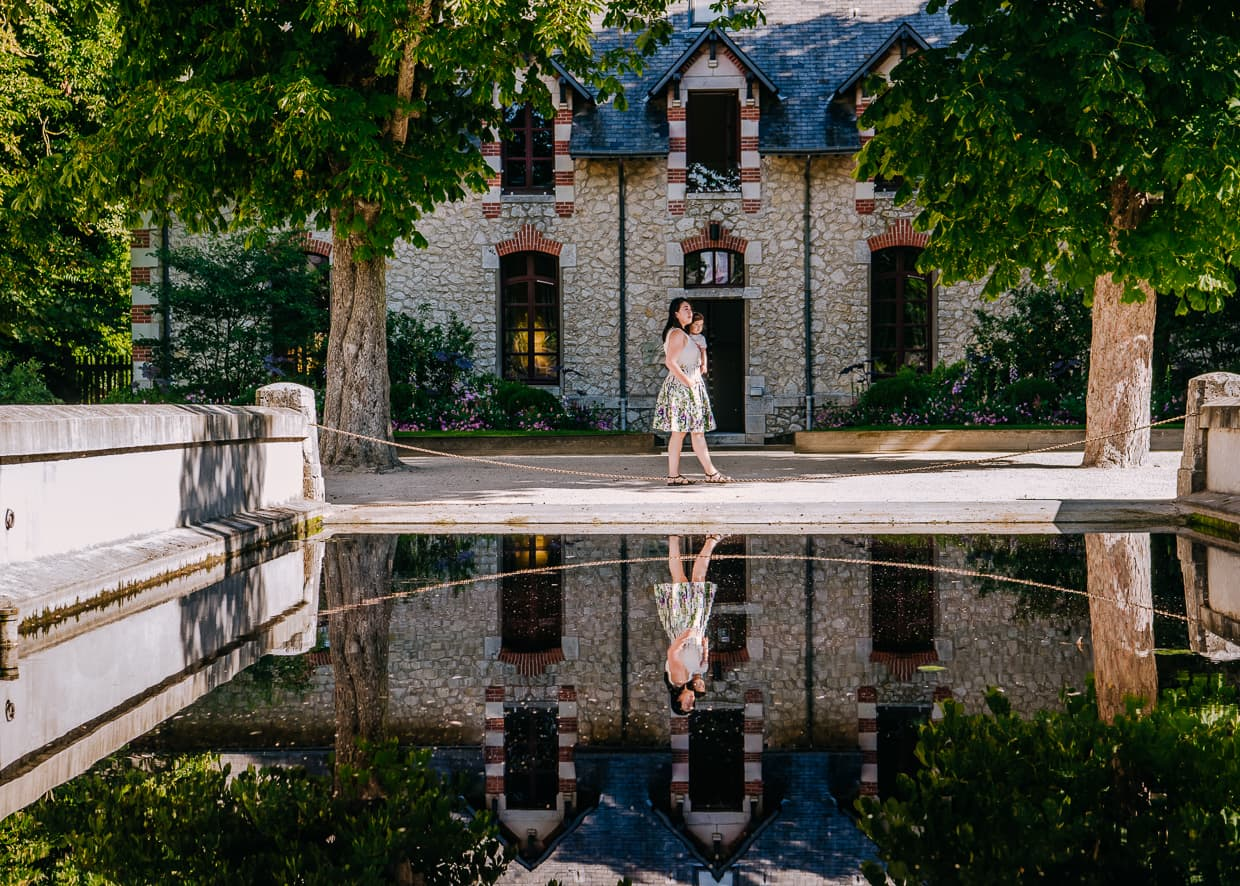 A reflection in front of the stables at Chateau de Chaumont.
