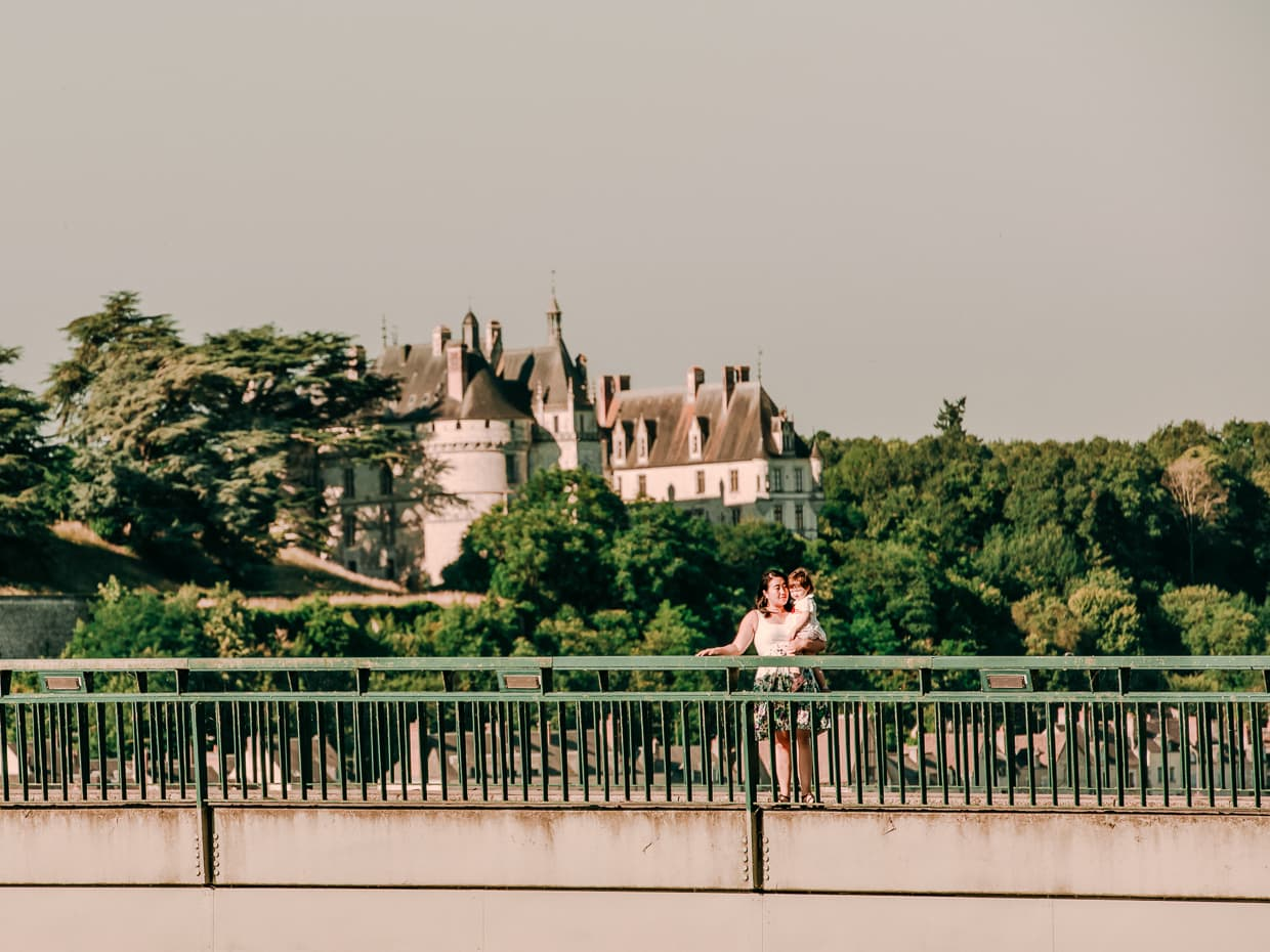 On a bridge over the Loire River in front of Chateau de Chaumont.
