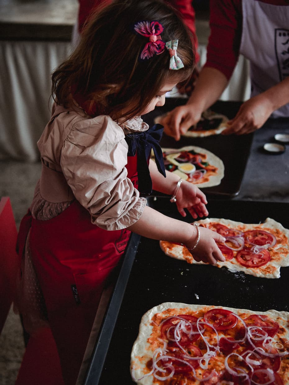 Preparing pizza during our first baking class in Dali, China.