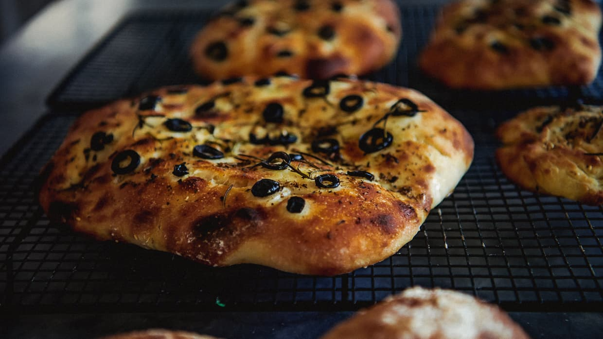A close up of our home made focaccia bread with olives.