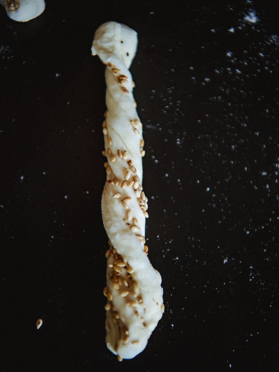 A sesame stick ready to be baked.