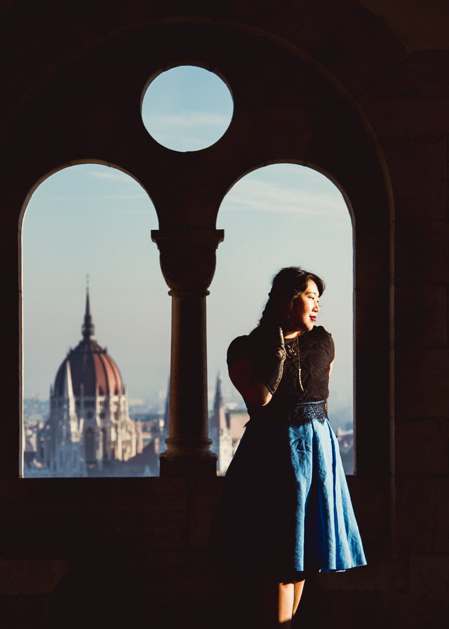 A window at the Fisherman's bastion with a view of the Parliament Building across the Danube in Budapest, Hungary.