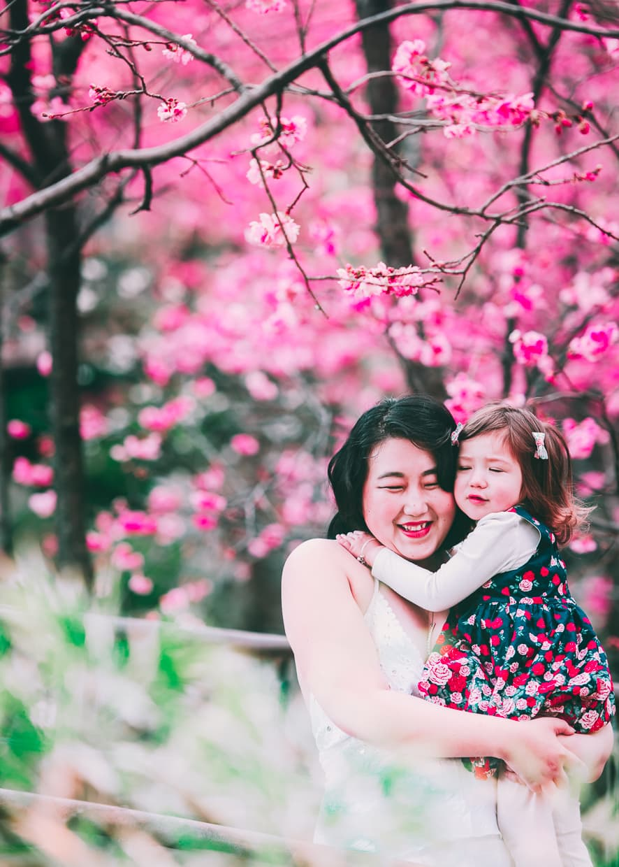 Mother and daughter under Chinese Cherry Blossom trees.
