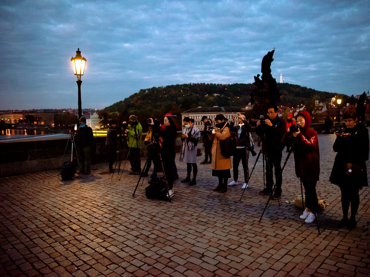 A wall of Chinese photographers in Prague on the Charles Bridge.