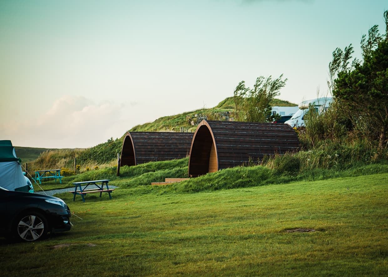 Wooden camping pods on the Isle of Skye in Scotland.