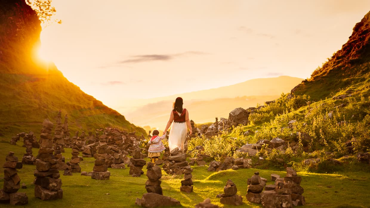 Waling through the cairns at Fairy Glen on the Isle of Skye at Sunset.