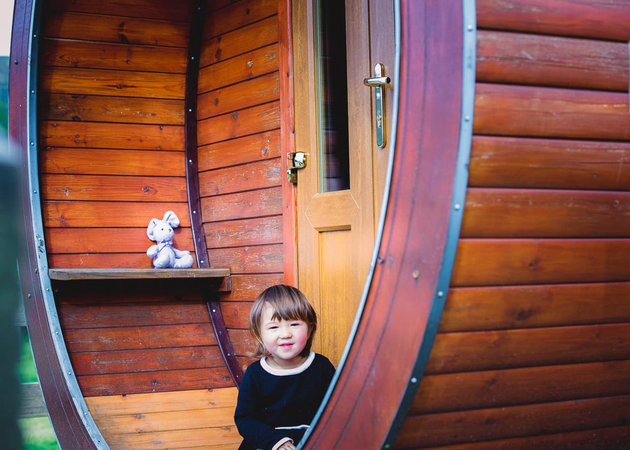 Lisa in front of a camping pod at Invercoe caravan and camping Park.
