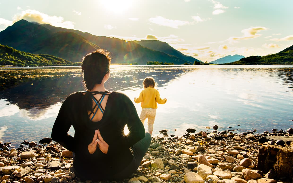 Yoga while camping in Glencoe, Scotland on Loch Leven.