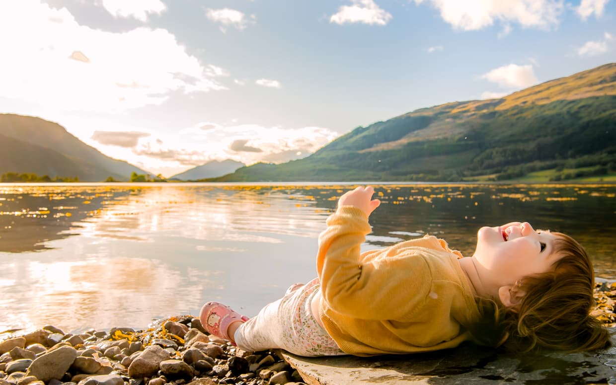 Relaxing on the shore of Loch Leven in Glencoe, Scotland. Invercoe Caravan and Camping Park.