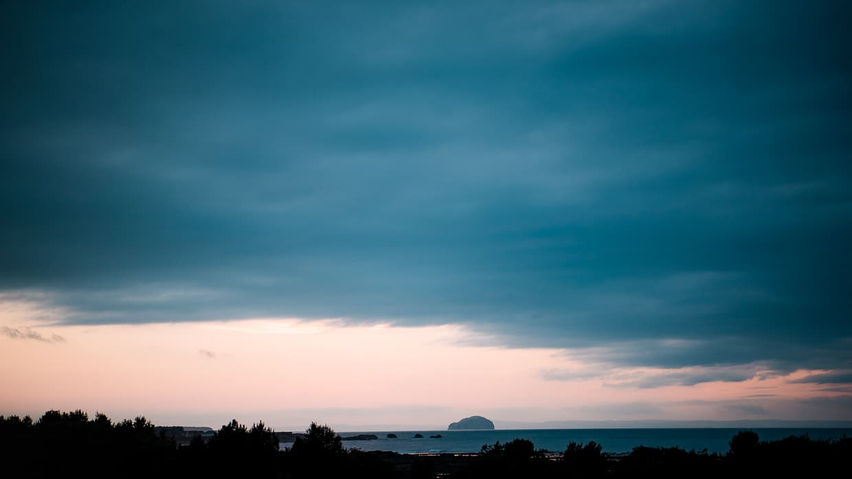 Bass rock at sunset from the Dunbar camping and caravanning club site in Scotland.