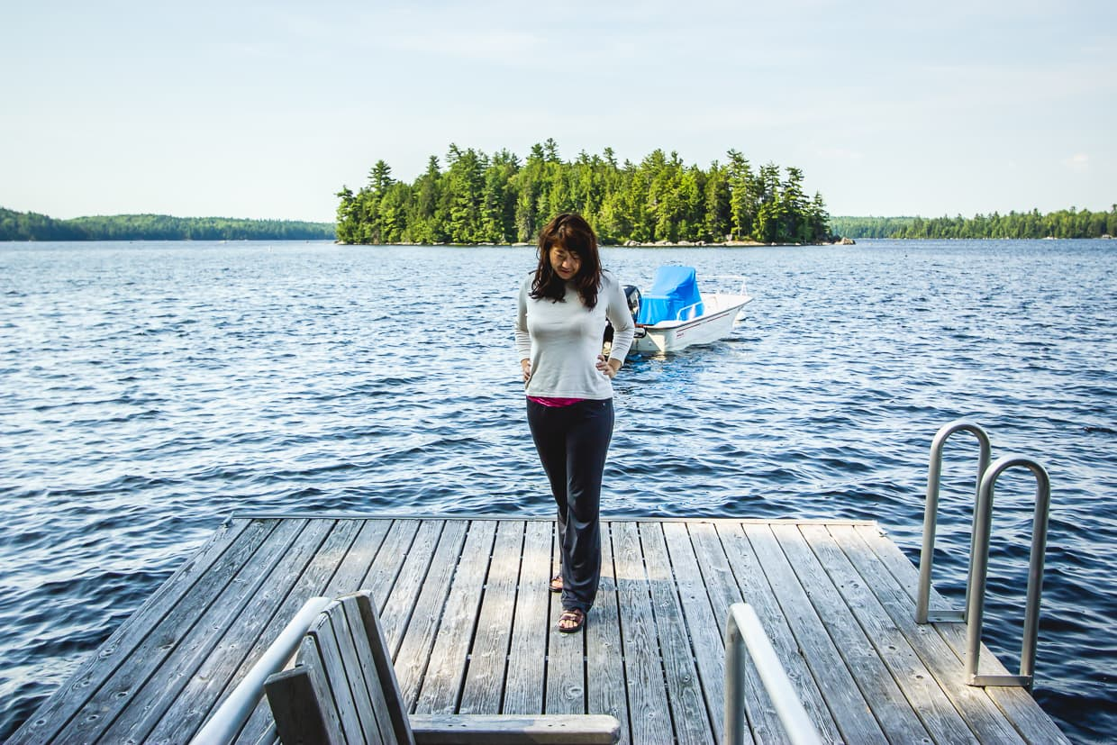 Standing on a dock by a lake near Bar Harbor, Maine.