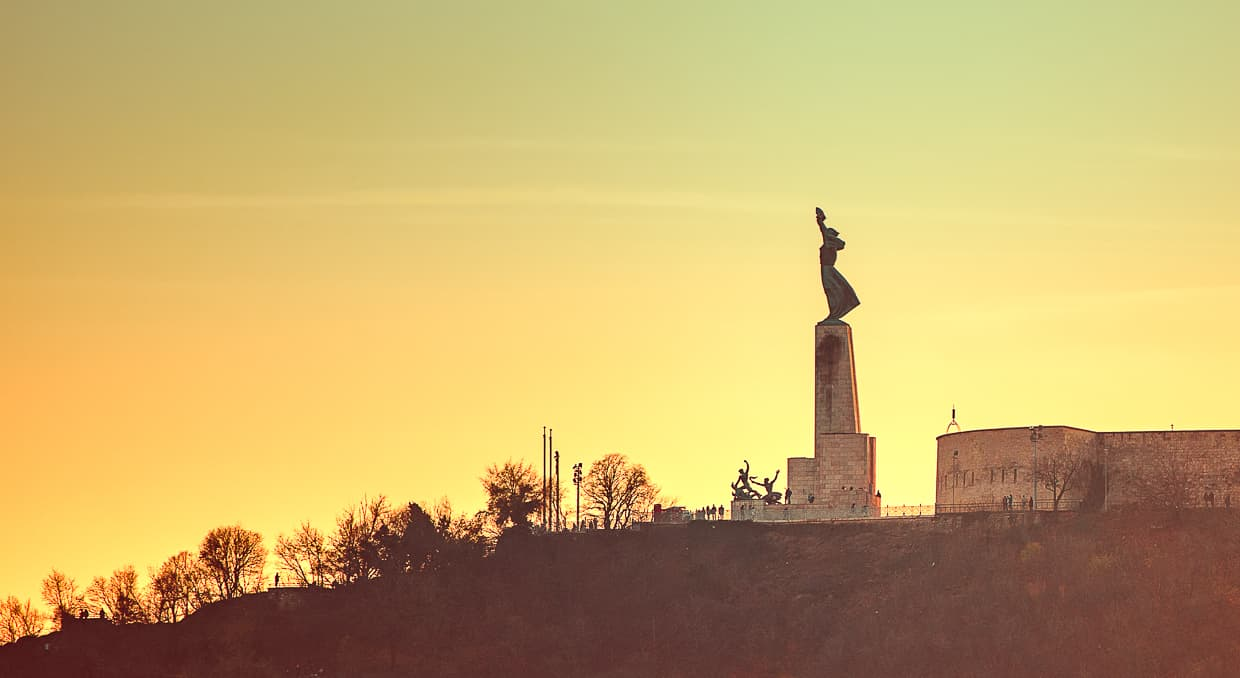 The Gellert Hill Liberty Statue at sunset.