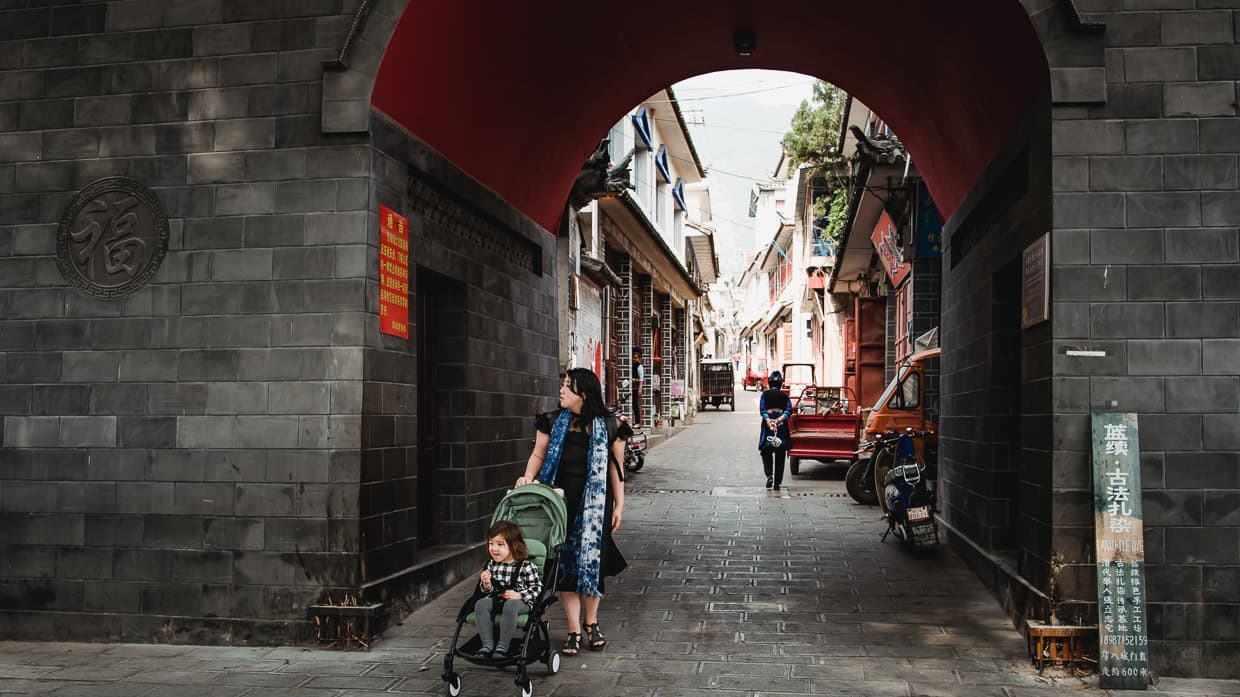 Walking through the Zhoucheng Old Town Gate Near Dali, China.