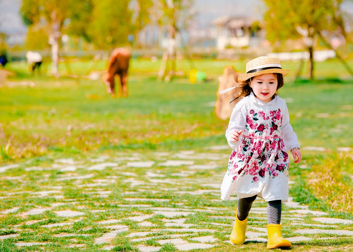 Lisa playing on a farm in Dali, China.