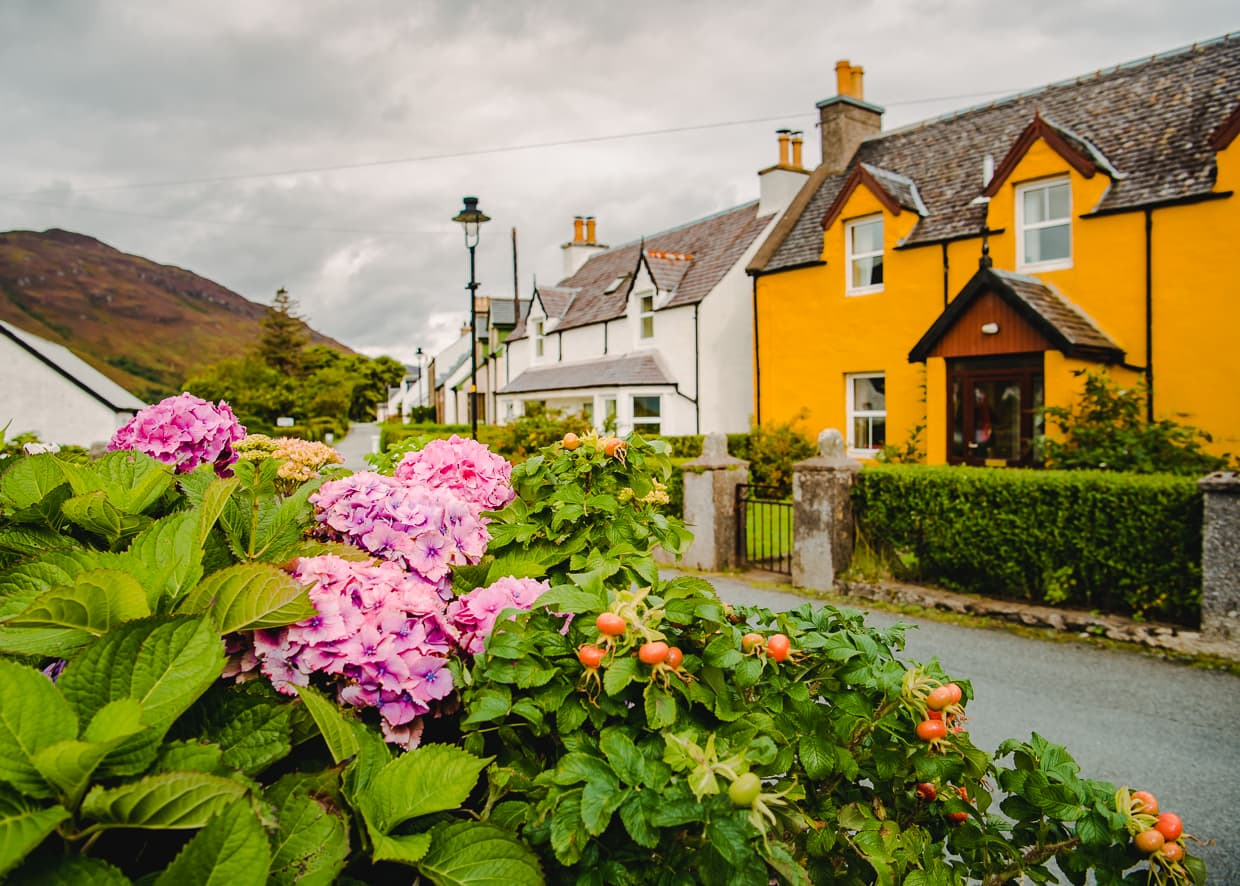Quaint houses and flowers in Dornie, Scotland.