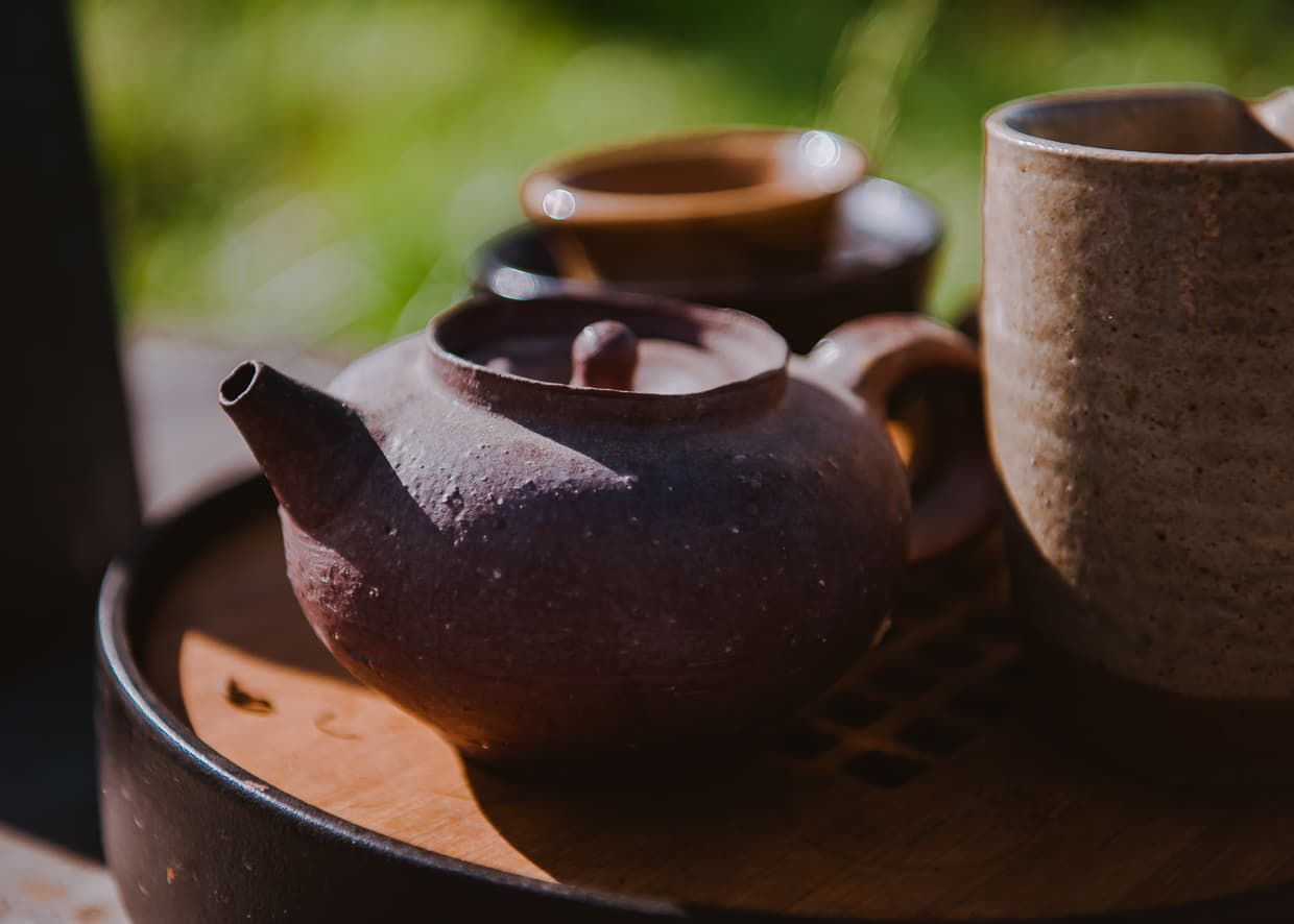 A pot of tea served outside.