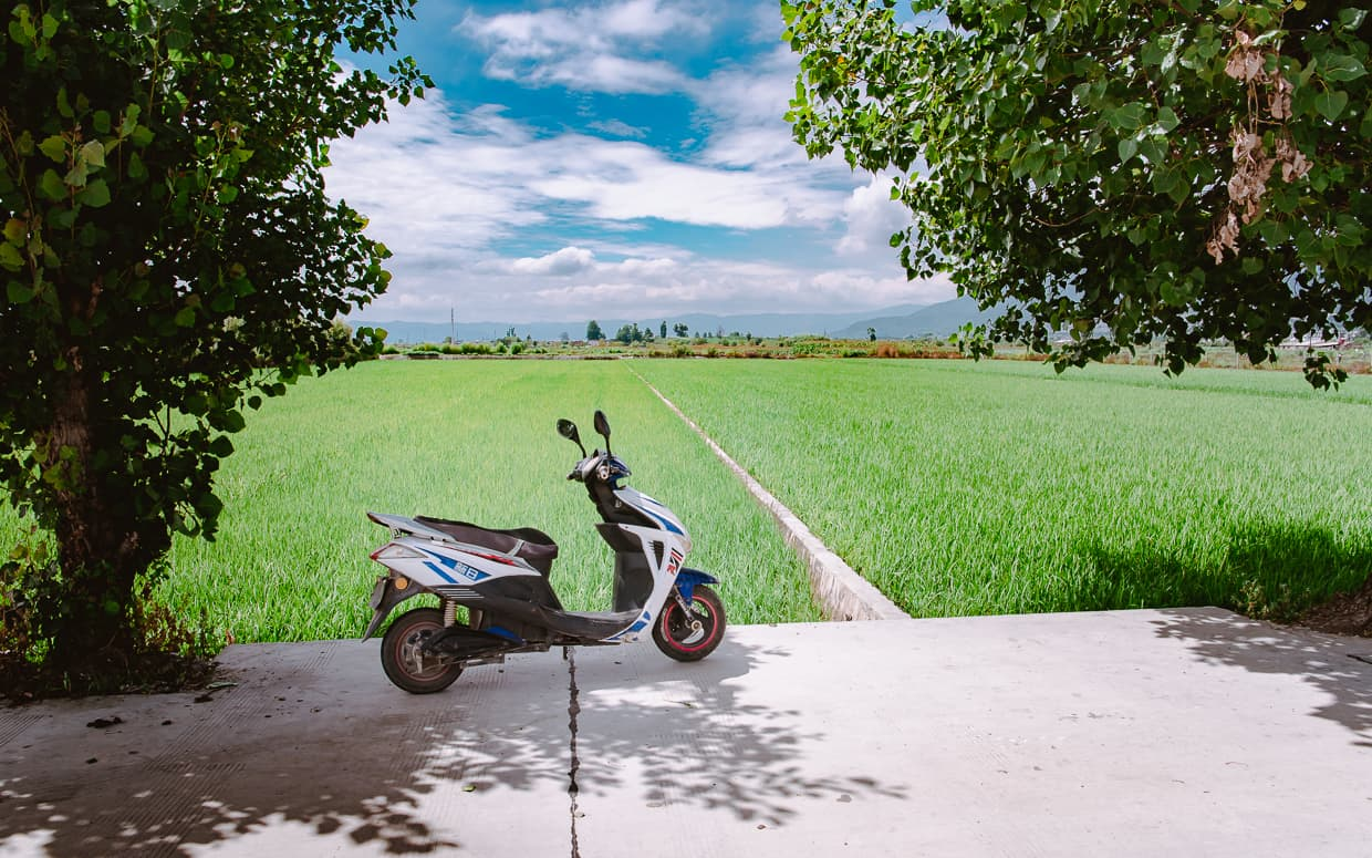 A motorcycle in the fields of Dali, China.