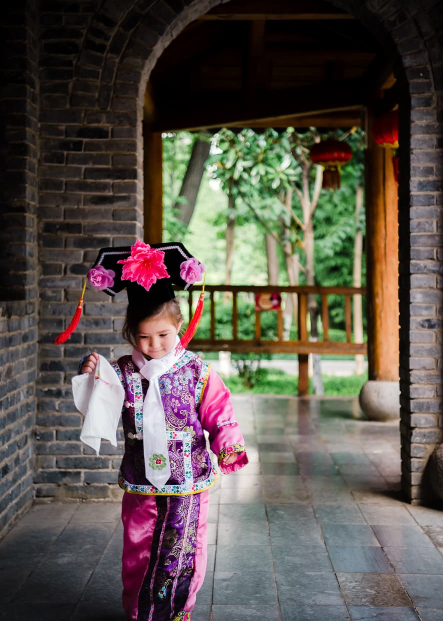 Wearing Manchurian clothing in the Kunming, China.