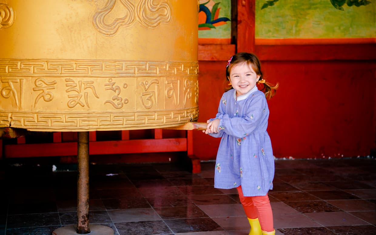 Turning a buddhist bell.