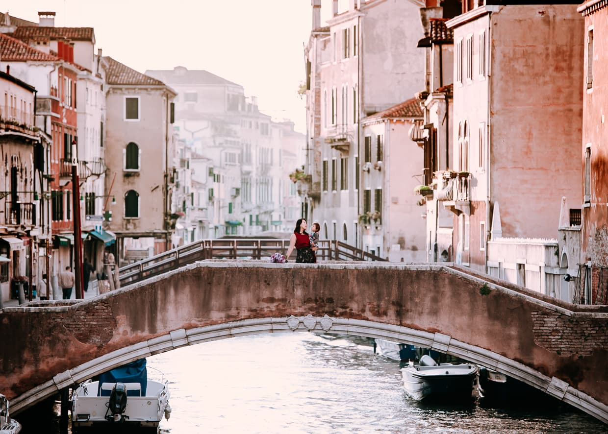 Walking over a bridge in Venice, Italy.