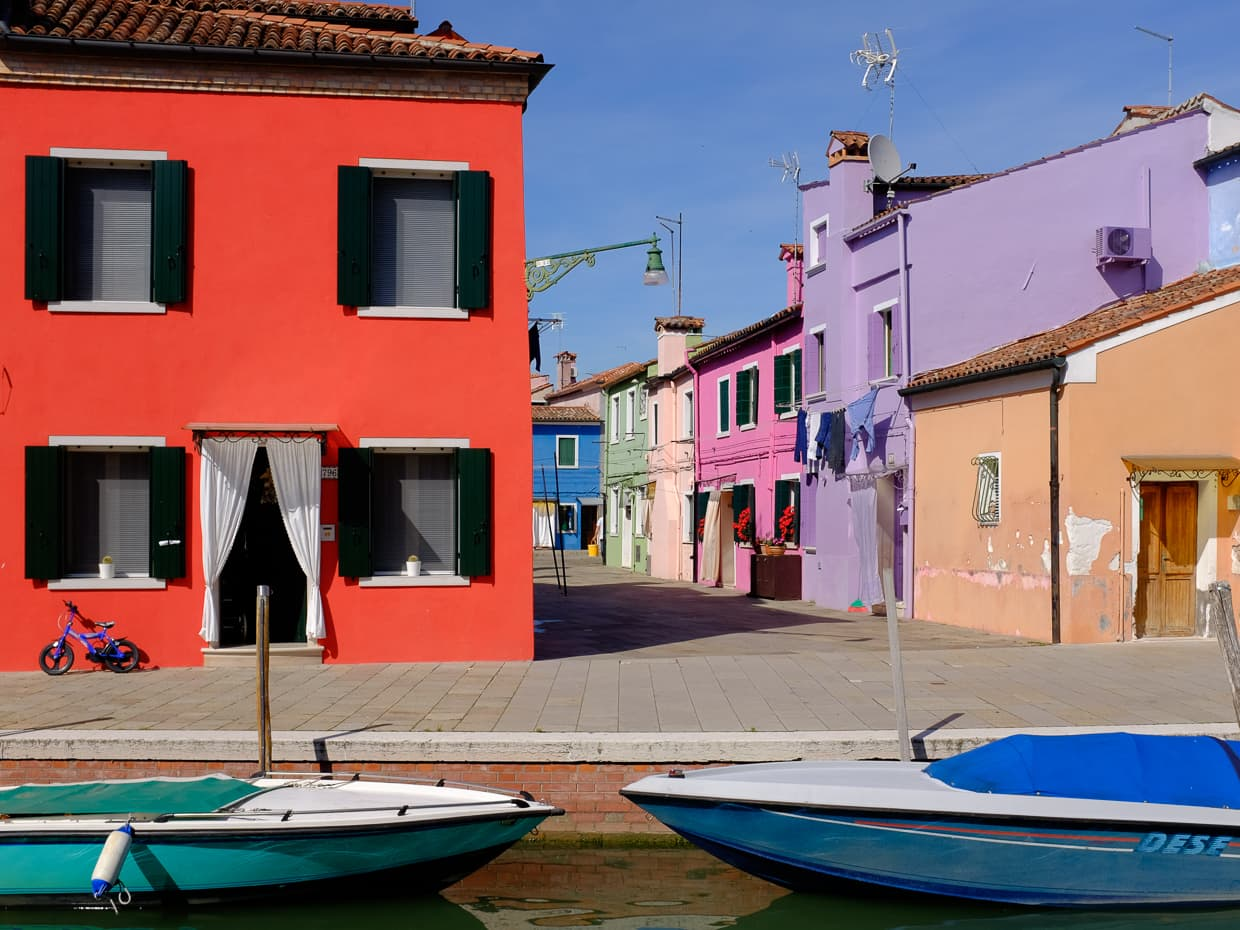 Boats and houses on Burano, Italy.
