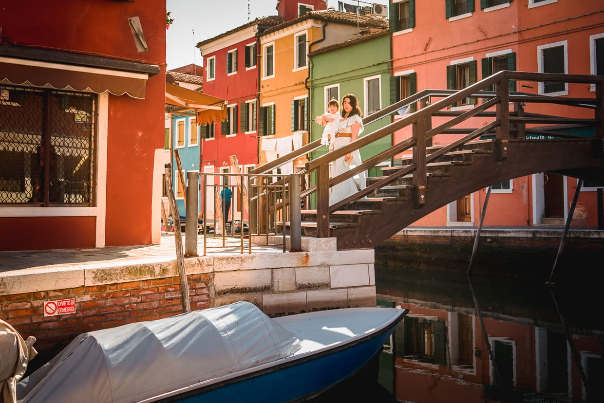 Exploring the colorful canals of Burano, Italy.