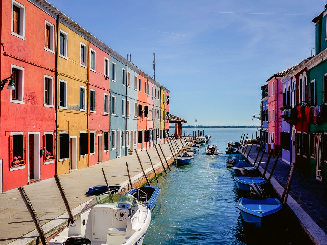 A canal in Burano and the Venetian Lagoon.