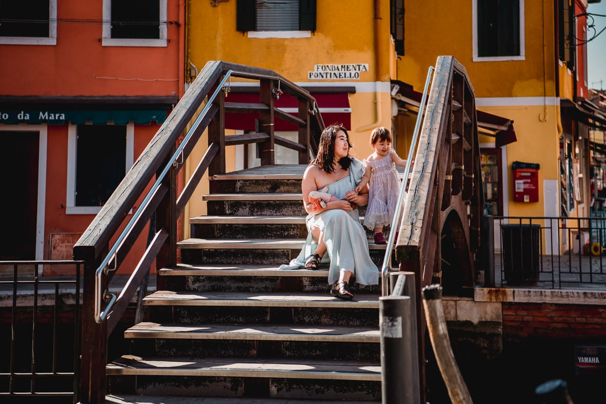 Resting on a bridge on the Island of Burano.
