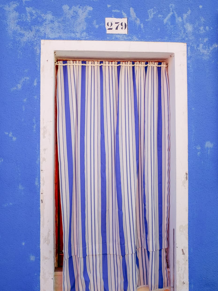 A blue door on the island of Burano.