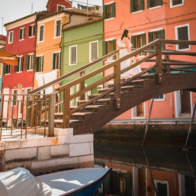 Walking over a bridge on the Venice Island of Burano in Italy