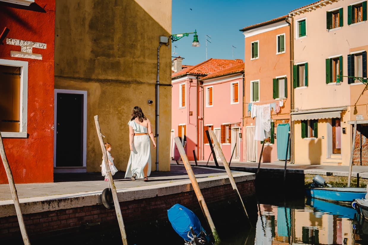 Walking along a Burano canal on our day trip from Venice, Italy.