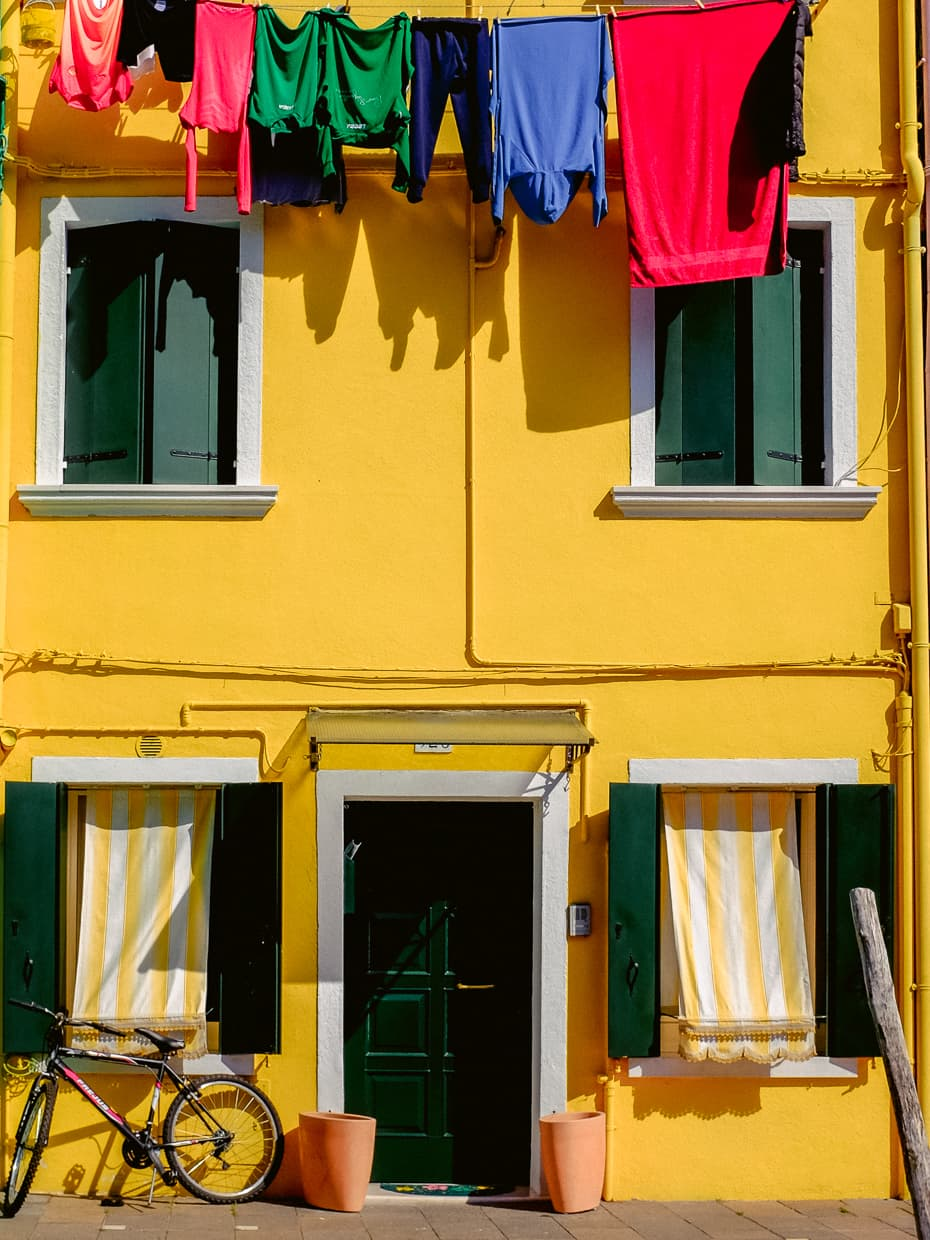 A bright yellow house on the island of Burano in Venice, Italy.