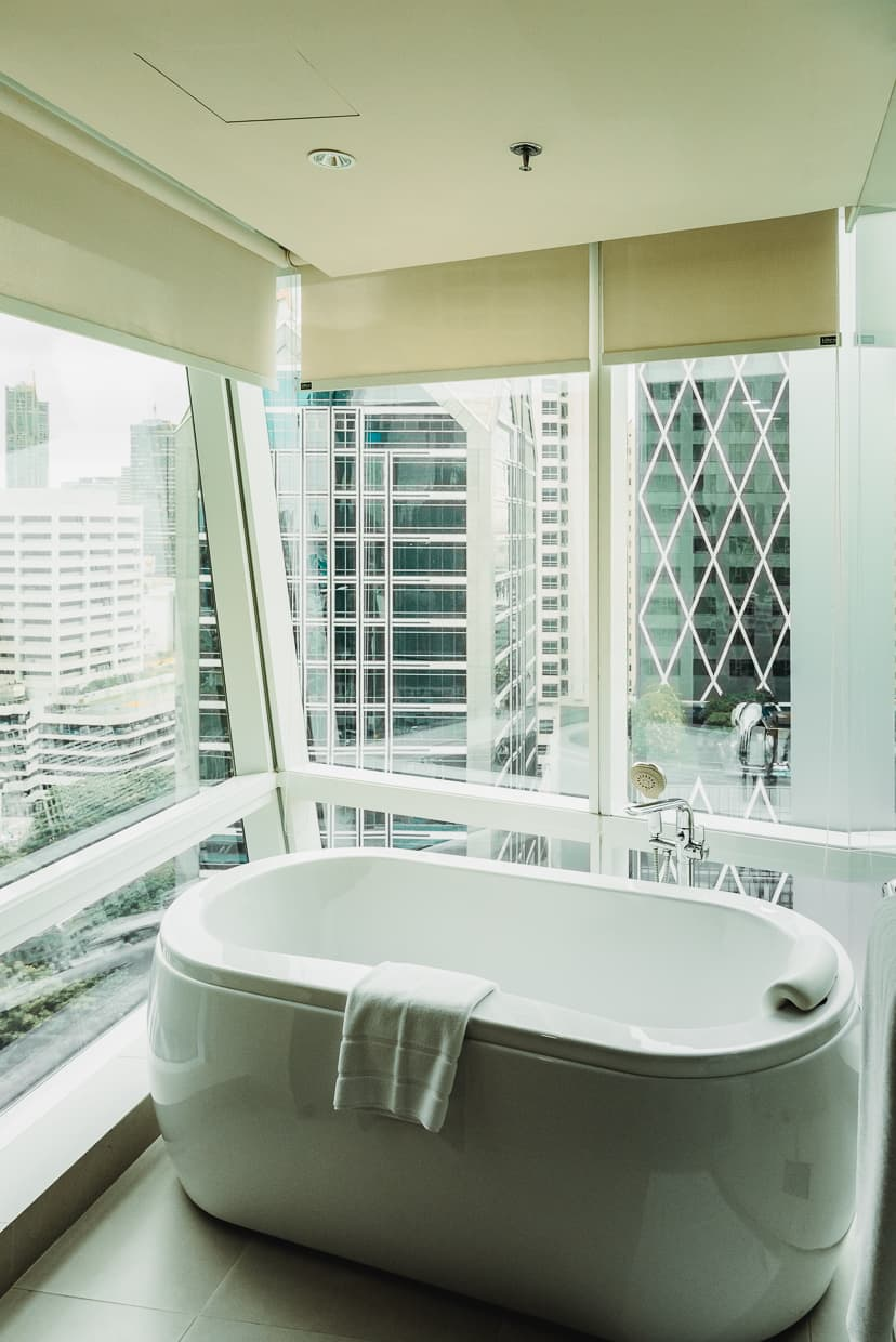 Bathtub window view Bangkok Thailand hotel.