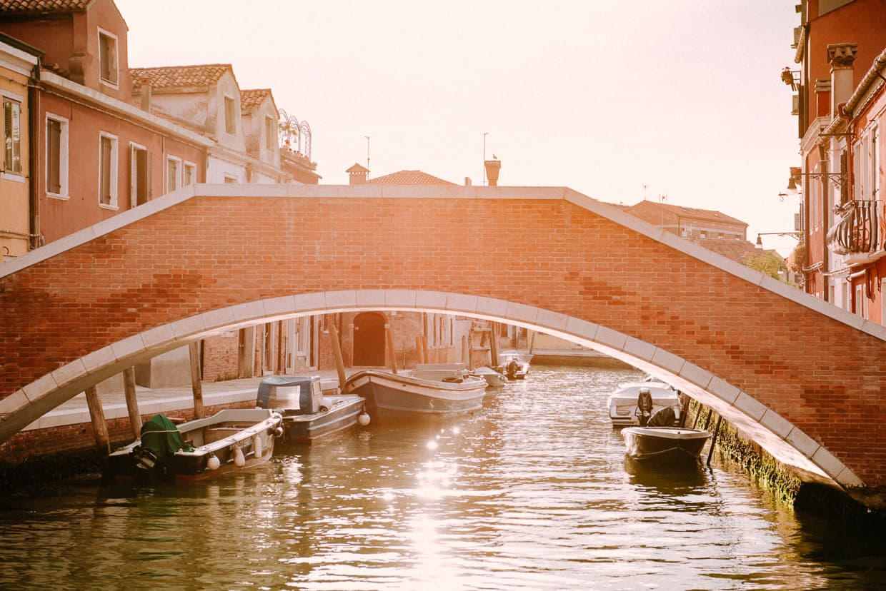 A bridge over a canal at sunrise on Murano near Venice, Italy.