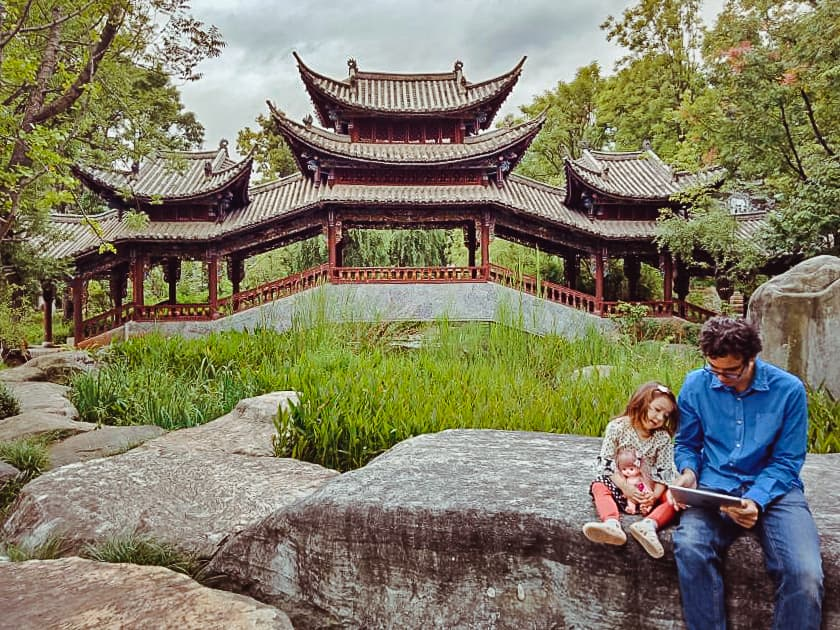 Father and daughter reading kindle books together in China.