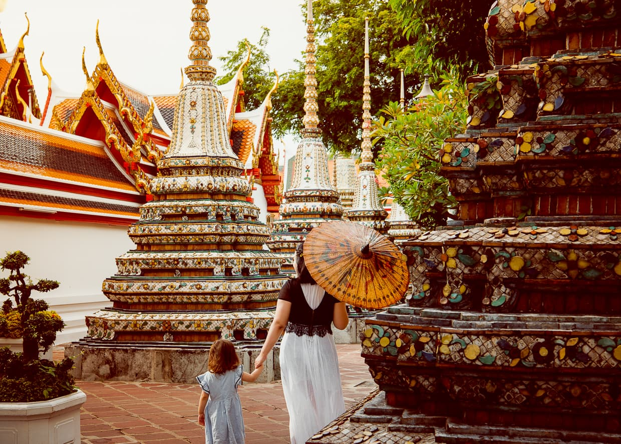 Walking by chedis in Wat Pho.