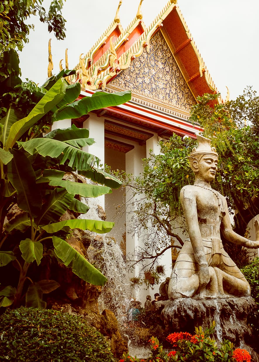 A statue in front of a temple at Wat Pho in Bangkok, Thailand.