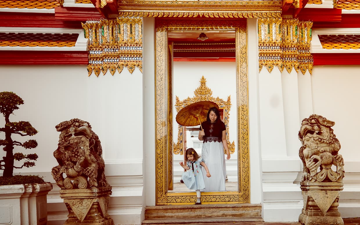Stepping over a doorframe in a Thai Buddhist Temple.