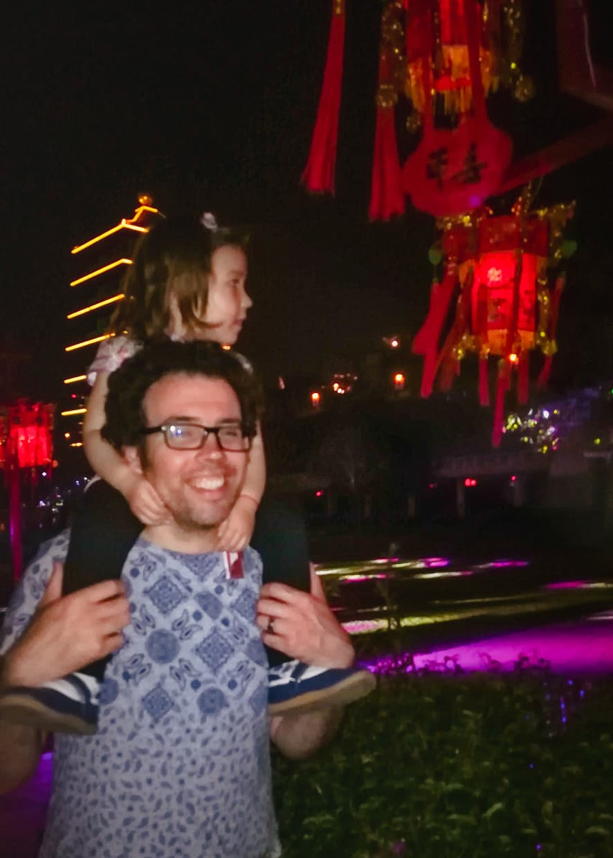 A blurry image of Lisa on Jake's shoulders.