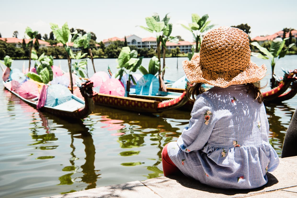 Sitting by dragon boats in the Dai Village in Kunming, China.