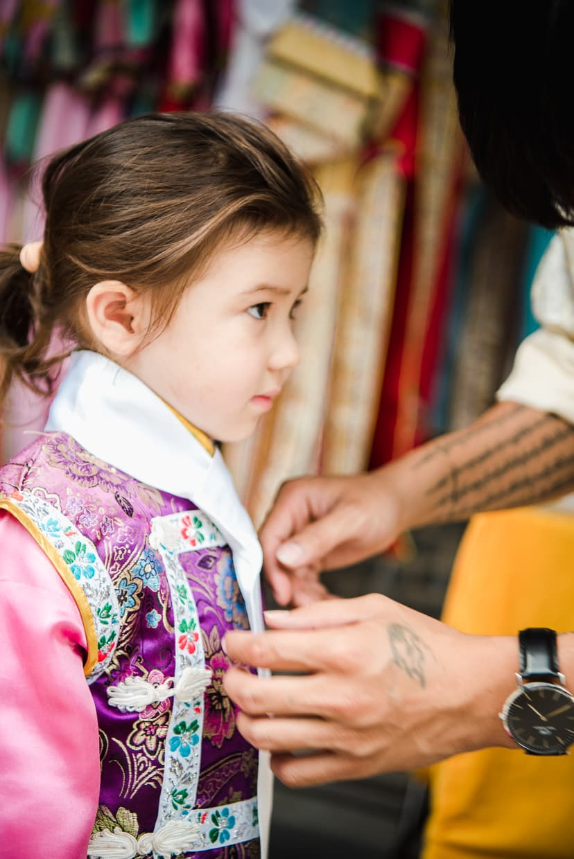 Dressing up in traditional Manchurian clothing in Kunming, China.
