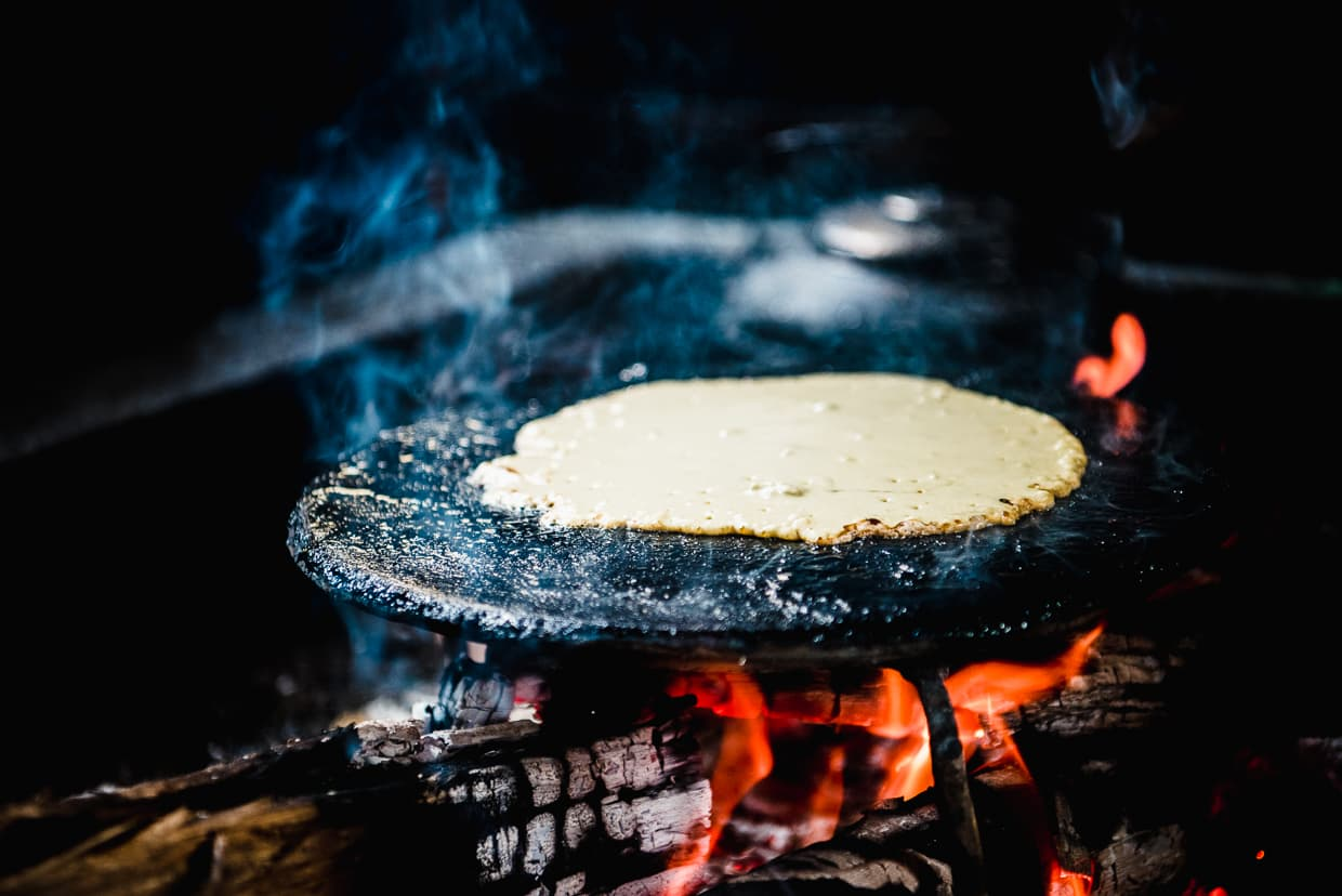 Nu People pancake cooking over fire.