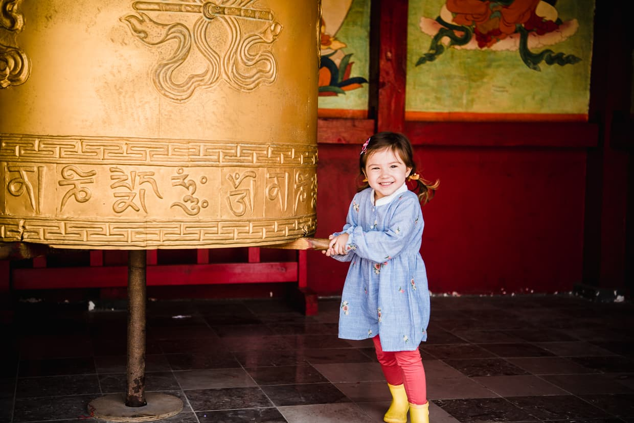 Child turning a Tibetan prayer wheel in the Yunnan Ethnic Village