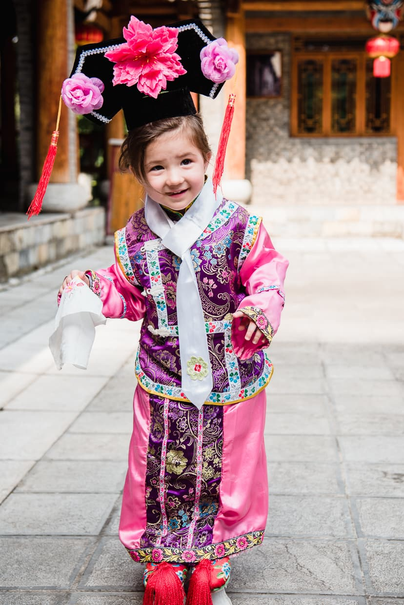 Trying on Manchurian clothes in the Yunnan Ethnic village.