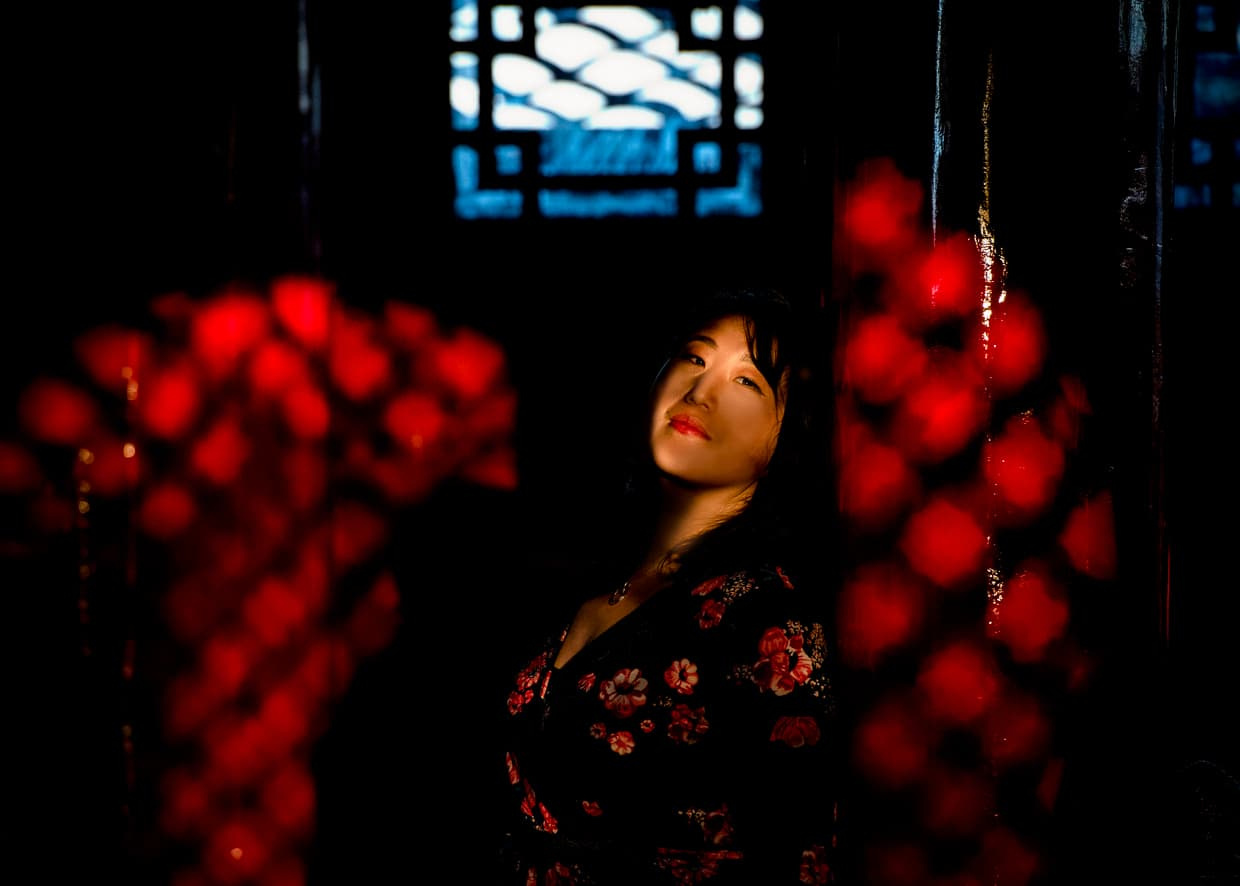 Taking advantage of cool lighting inside Wangu Tower on Lijiang's Lion Hill.