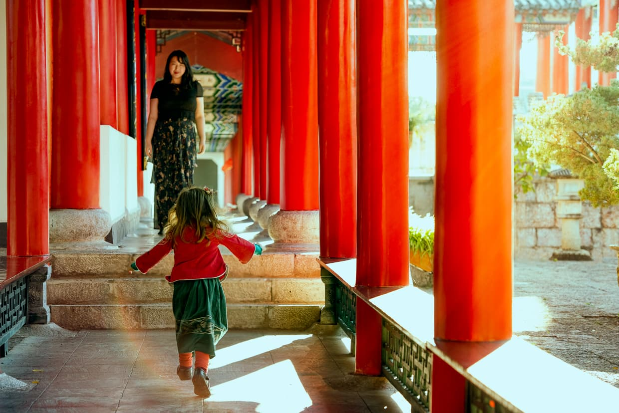Toddler running to mother in Lijiang, China.