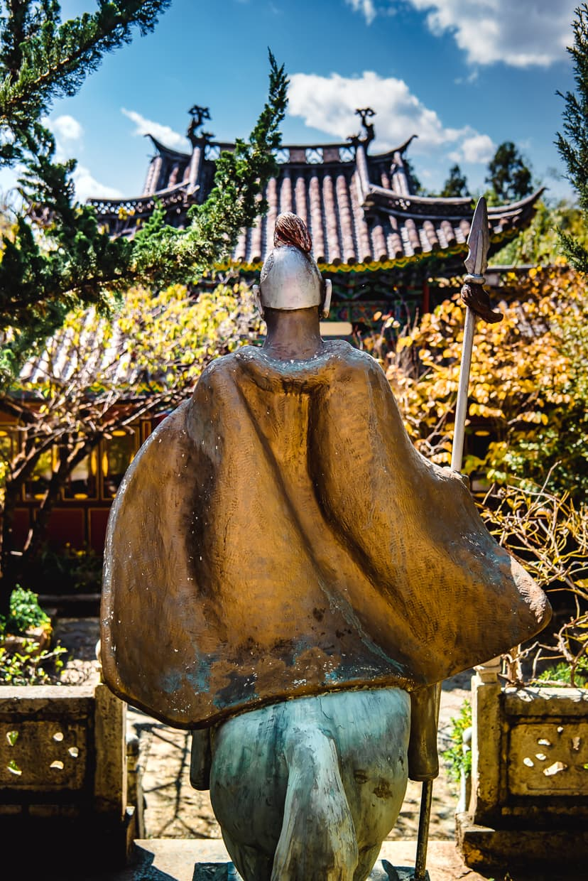A statue in front of a Buddhist temple in Lijiang, China.