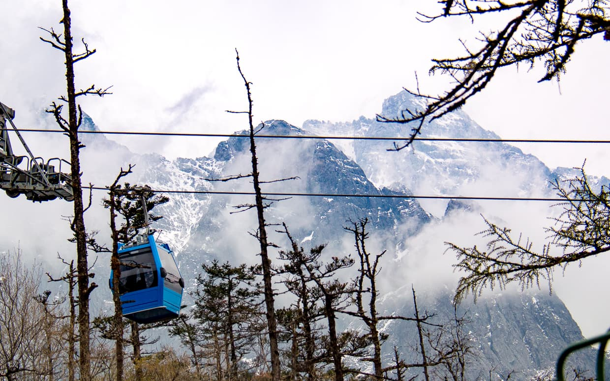 A gondola making it's way up Jade Dragon Snow Mountain in Lijiang, China.
