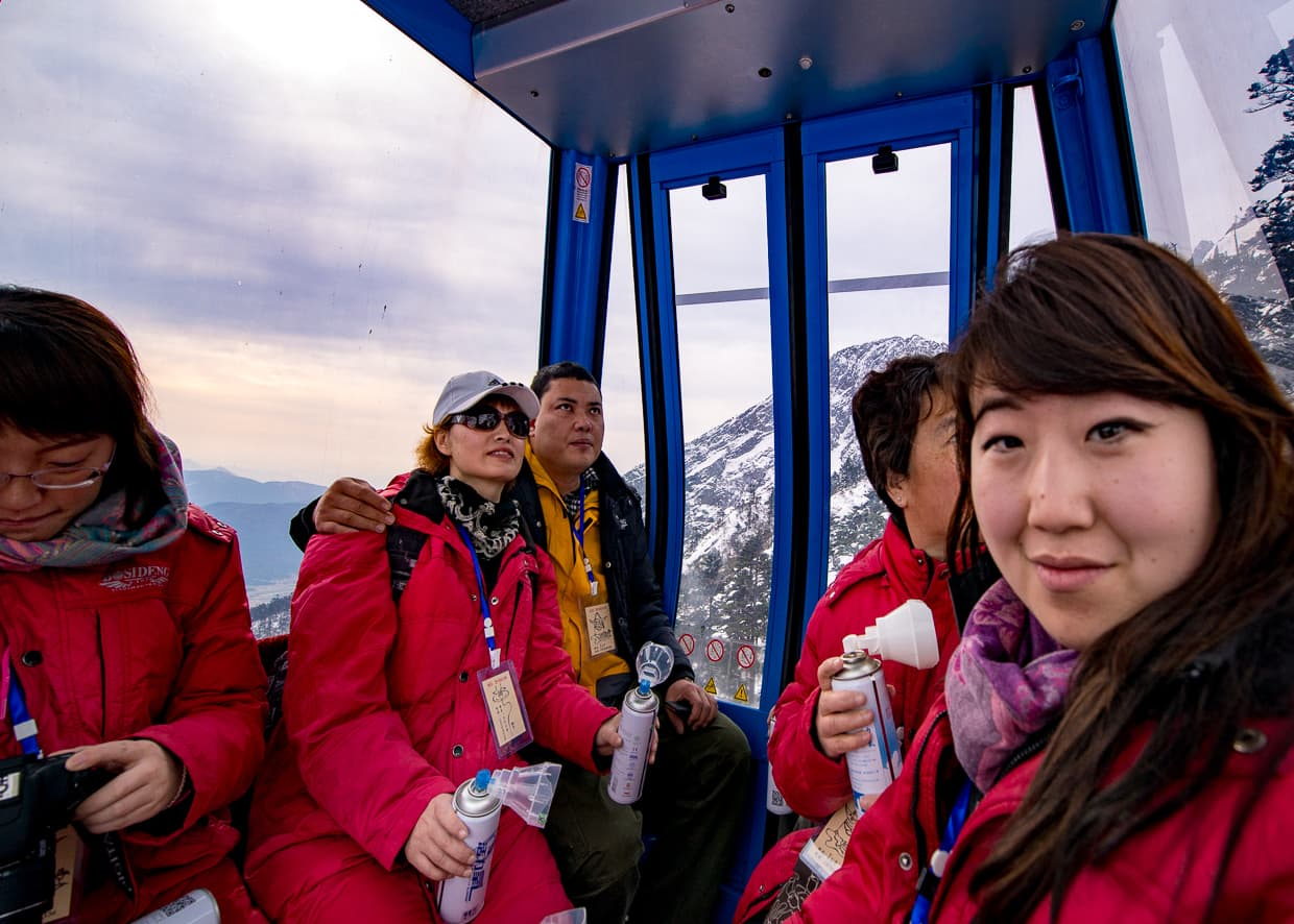 Dannie and other tourists inside the Gondola. Lijiang, China.